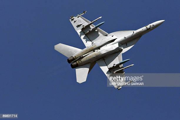 This photograph taken on February 10 shows a US Navy F/A18F Super Hornet strike aircraft performing a roll during a flight demonstration at the...