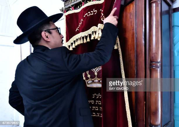 This photograph taken on February 17 2017 shows Indonesian Rabbi Yaakov Baruch at a synagogue in Tondano North Sulawesi In a remote corner of the...