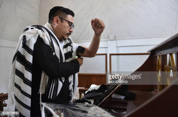 This photograph taken on February 17 2017 shows Indonesian Rabbi Yaakov Baruch in prayer at a synagogue in Tondano North Sulawesi In a remote corner...