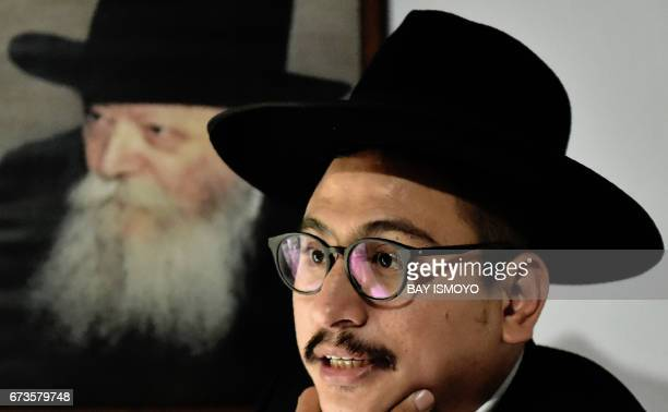 This photograph taken on February 17 2017 shows Indonesian Rabbi Yaakov Baruch answering questions during an interview at a synagogue in Tondano...