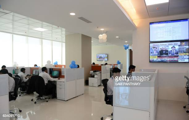 This photograph taken on January 23 employees work at India's first India International Exchange a 100 per cent subsidiary of the Bombay Stock...