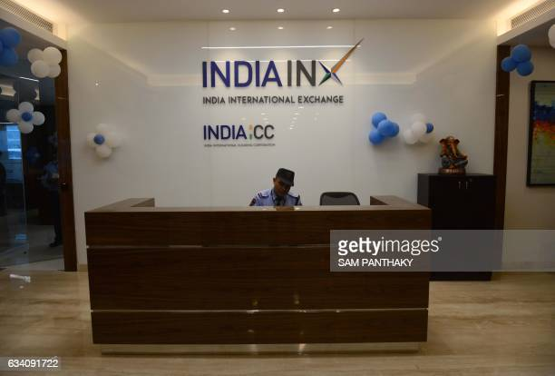 This photograph taken on January 23 shows an Indian security guard at the entrance to The Hiranandani Signature Tower which houses India's first...
