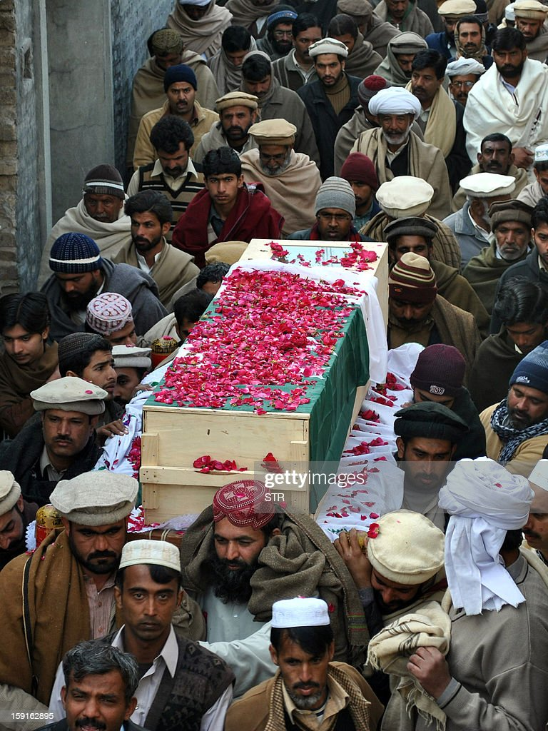 This photograph taken on January 8, 2013, relatives and mourners carry the coffin of Pakistani soldier Mohammad Aslam, who was killed during a border post attack in the Haji Pir sector of Pakistan-administered Kashmir by Indian soldiers, during his funeral in Khairpur village Chakwal district. Pakistani and Indian troops exchanged fire on January 6 along their hotly disputed border in divided Kashmir, with each side accusing the other of starting the clash. Pakistan on January 9 denied an Indian claim that its troops killed two Indian soldiers in a cross-border attack on January 8 that has raised tensions in South Asia, a military official said.