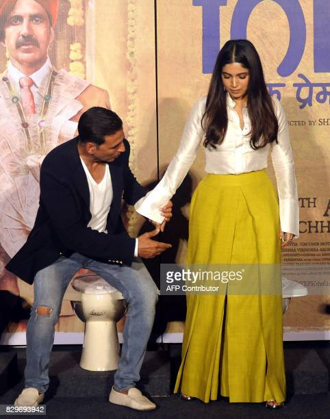 This photograph taken on July 27 2017 shows Indian Bollywood actors Akshay Kumar and Bhumi Pednekar attending a press conference for the Hindi film...