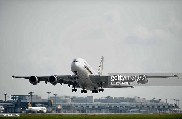 This photograph taken on July 29 2014 shows a Singapore Airlines A380 passenger plane taking off on a runway at Changi International Airport in...