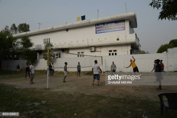 This photograph taken on June 12 shows Indian patients as they play volleyball at the Life Care Rehabilitation Centre on the outskirts of Jalandhar...