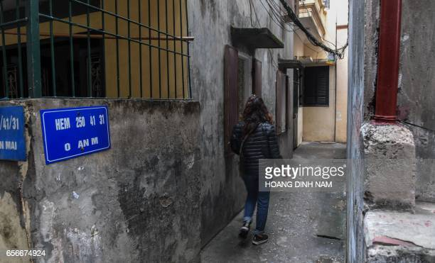 This photograph taken on March 15 2017 shows Nga mother of an eightyearold abused girl walking toward the place where the little girl was molested in...