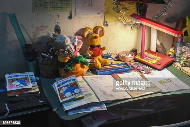 This photograph taken on March 15 2017 shows the study table of a eightyearold abused girl in her home in Hanoi Nga's eightyearold daughter still...