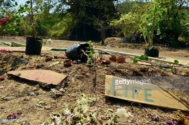 This photograph taken on March 17 shows artifacts placed by mourners at the location where the body of Irish tourist Danielle McLaughlin was found in...