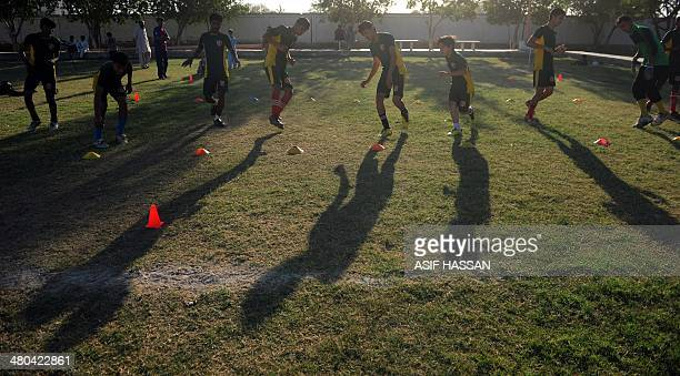 WITH 'FBLPAKCHILDRENPOVERTY' FOCUS This photograph taken on March 17 shows Pakistani street children taking part in a football training camp in...