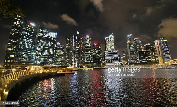 This photograph taken on March 4 2016 shows the skyline of the Singapore financial business district at night Singapore retains the top spot in the...