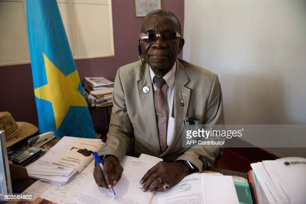 This photograph taken on May 10 shows Benjamin Mumba Mufumpo Head of the Provincial Division of Arts and Culture in his office in Lubumbashi DR Congo...