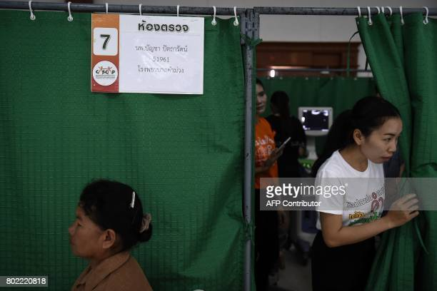 This photograph taken on May 19 2017 shows a health worker calling a patient for an ultrasound during a CASCAP event in the northeastern Thai...