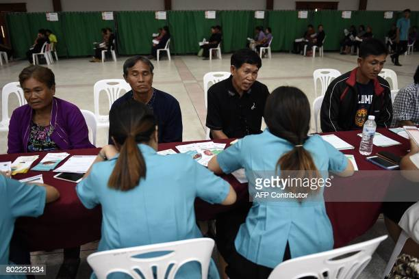 This photograph taken on May 19 2017 shows nurses speaking to patients about their ultrasound results during a CASCAP event in the northeastern Thai...
