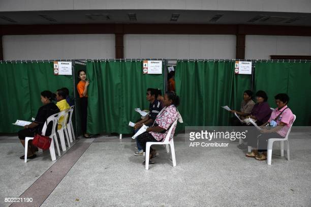 This photograph taken on May 19 2017 shows patients waiting for ultrasounds during a CASCAP event in the northeastern Thai province of Kalasin...
