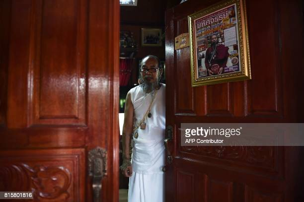 This photograph taken on May 20 2017 shows 'hermit' Toon at the door of the prayer room at his home in the northern Thai province of Khon Kaen From...