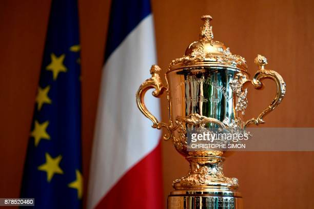 This photograph taken on November 24 shows The Webb Ellis Cup The World Cup of Rugby Union on display at the French Sports Ministry in Paris France...