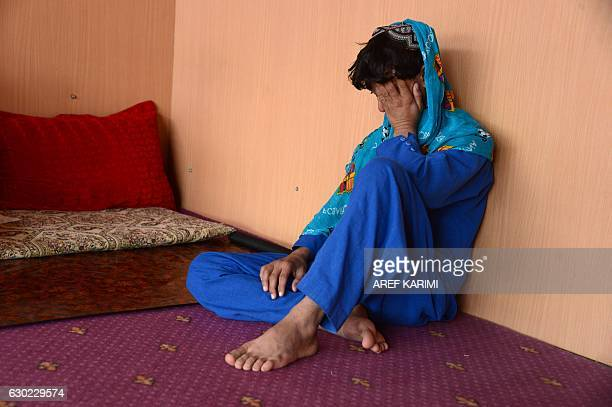 This photograph taken on October 31 2016 shows an Afghan boy who was held as a child sex slave sitting at a restaurant in a unidentified location in...