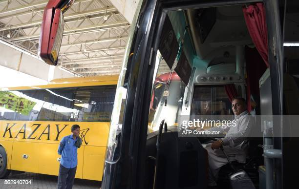This photograph taken on October 8 2017 shows Pakistani bus driver Meher Muhammad Khalil who drove the Sri Lankan cricket team to safety when it came...