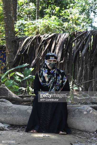 This photograph taken on September 16 2017 shows Shamila a 25yearold Rohingya refugee victim of rape posing for a picture at the Jalpatoli refugee...