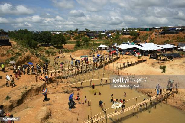 TOPSHOT This photograph taken on September 24 2017 shows a general view of the newlyexpanded camp housing refugees from Myanmar known as Kutupalong...