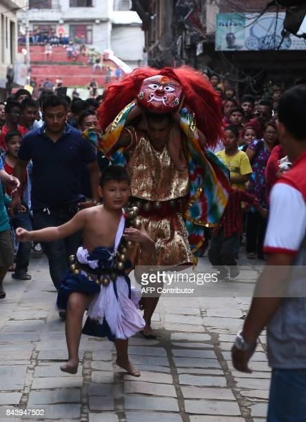 This photograph taken on September 3 2017 shows Nepali Lakhe dancer Laxman Ranjit and his son Arayan Ranjit performing the 'Lakhe' dance in Kathmandu...