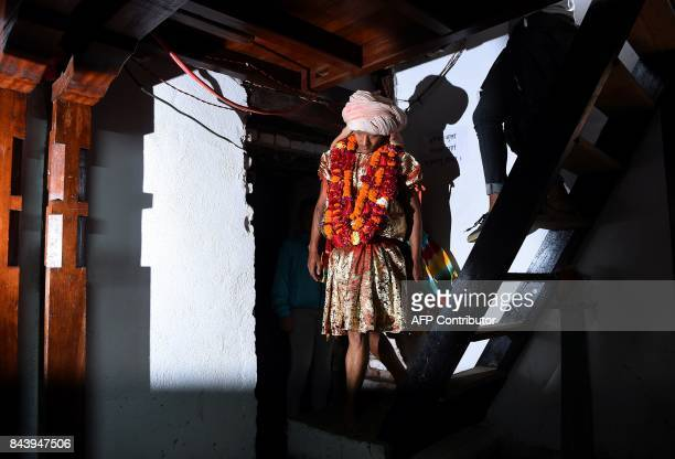 This photograph taken on September 3 2017 shows Nepali Lakhe dancer Laxman Ranjit arrives to put on his costume before performing the 'Lakhe' dance...