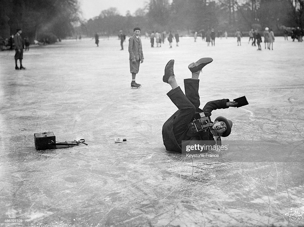 This photographer has slipped and fallen on the ice while taking a picture at the Bois de Boulogne in 1929 in Paris, France.