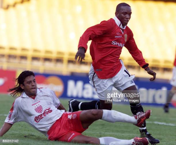 This picture can only be used within the context of an editiorial feature Manchester United's Dwight Yorke is blocked by Necaxa'a Sergio Almaguer...