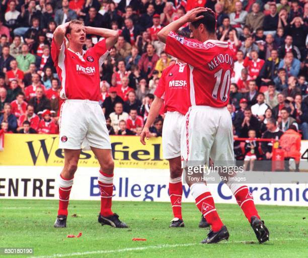 This picture can only be used within the context of an editorial feature Charlton's Carl Tiler and Clive Mendonca hold their heads after a near miss...