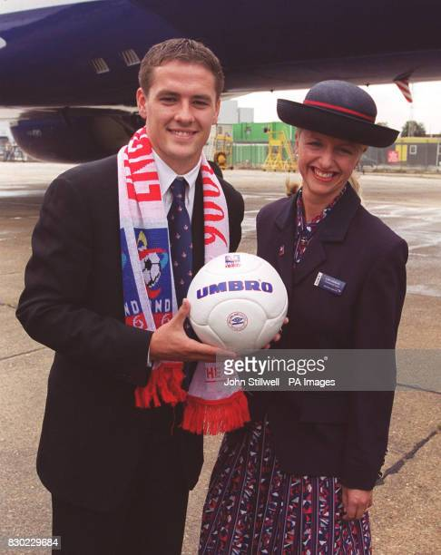 This picture can only be used within the context of an editorial feature England striker Michael Owen and British Airways' Lisa Horan at Heathrow...