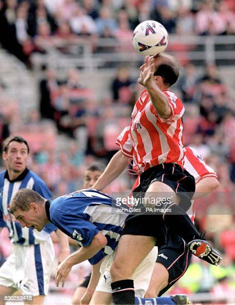 This picture can only be used within the context of an editorial feature Perfect balance from Steve Bould of Sunderland as he beats Andy Booth of...