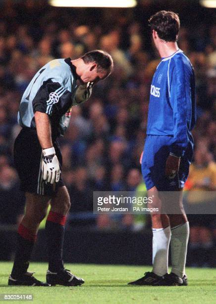 This picture can only be used within the context of an editorial feature Galatasaray keeper Claudio Taffarel walks past Chelsea's Chris Sutton after...