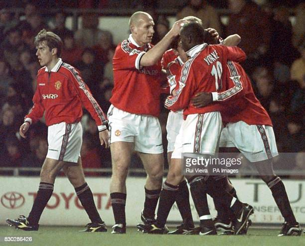 This picture can only be used within the context of an editorial feature Manchester United players Jaap Stam and Dwight Yorke congratulate Andy Cole...