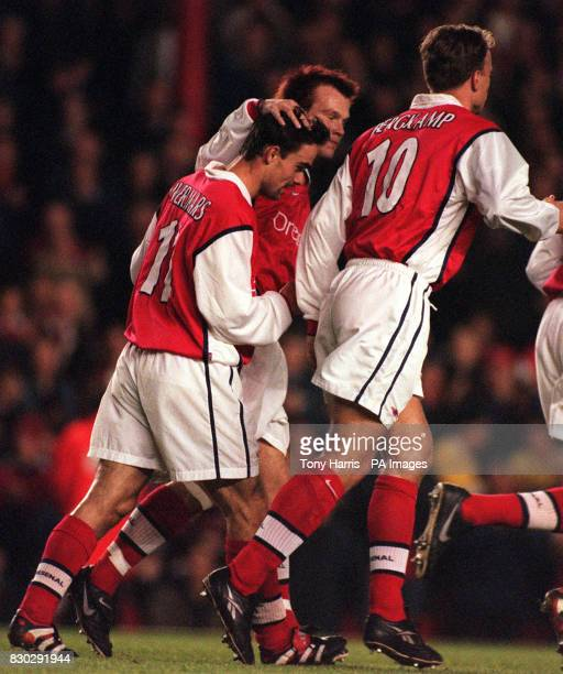 This picture can only be used within the context of an editorial feature Arsenal's Marc Overmars is congratulated by Frederick Ljungberg and Dennis...