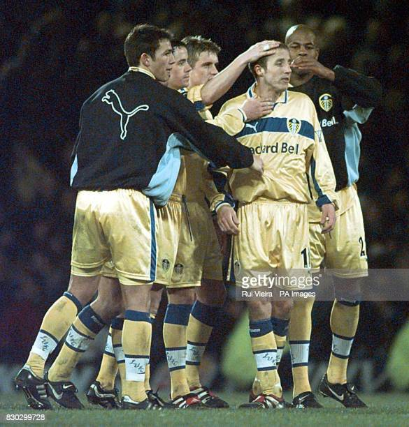 This picture can only be used within the context of an editorial feature Leed's Lee Bowyer is consoled by team mates after missing a penalty during...
