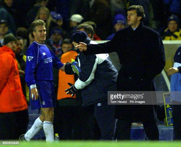 This picture can only be used within the context of an editorial feature Chelsea's Didier Deschamps appears to be restrained by Chelsea officials...