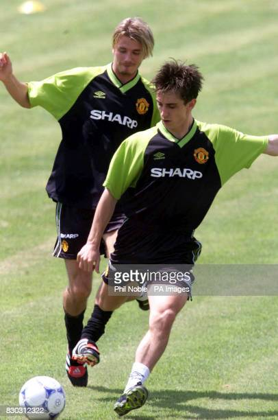 This picture can only be used within the context of an editorial feature Manchester United's David Beckham and Gary Neville during a training session...