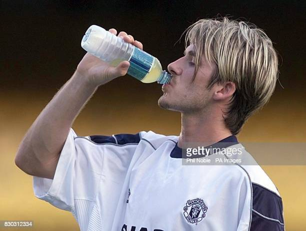 This picture can only be used within the context of an editorial feature Manchester United's David Beckham feels the heat during a training session...