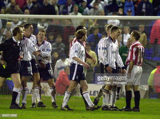 This picture can only be used within the context of an editorial feature Tranmere Rovers' Clint Hill argues with Sunderland's Alex Rae as referee Rob...