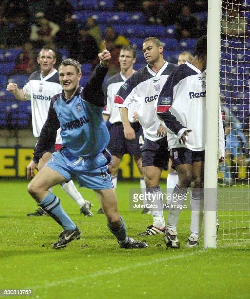 This picture can only be used within the context of an editorial feature Clint Hill of Tranmere Rovers celebrates his goal while Bolton look dejected...