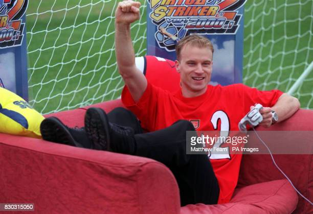 This picture can only be used within the context of an editorial feature Arsenal soccer star Dennis Bergkamp plays Virtua Striker 2 on the Sega...