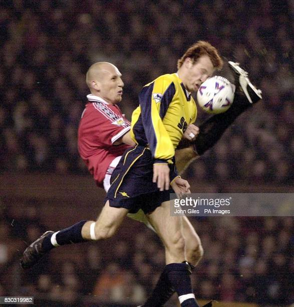 This picture can only be used within the context of an editorial feature Arsenal's Fredrik Ljungberg heads the ball to beat Manchester United's Jaap...