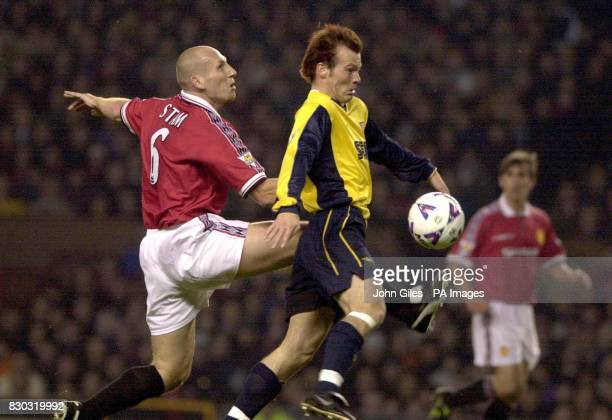 This picture can only be used within the context of an editorial feature Arsenal's Fredrik Ljungberg beats Manchester United's Jaap Stam to the ball...