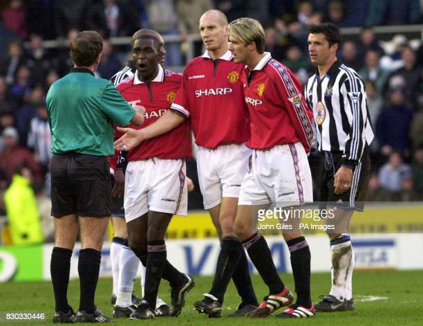This picture can only be used within the context of an editorial feature Manchester United players Andy Cole Jap Stam and David Beckham argue with...