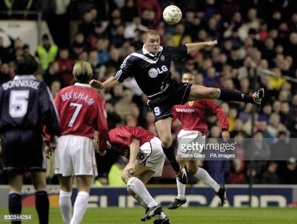 This picture can only be used within the context of an editorial feature Lilian Laslandes of FC Bordeaux rises above Jaap Stam of Manchester United...