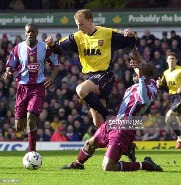 This picture can only be used within the context of an editorial feature Aston Villa's Ugo Ehiogu intercepts Arsenal's Dennis Bergkamp during their...