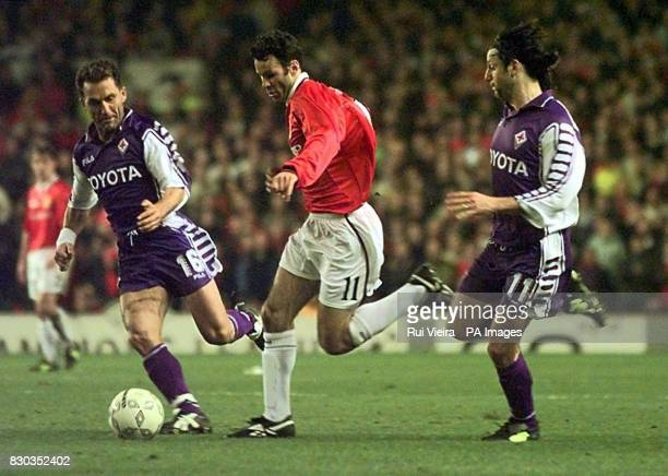 This picture can only be used within the context of an editorial feature Manchester United's Ryan Giggs dribbles past Fiorentina's Angelo Di Livio...