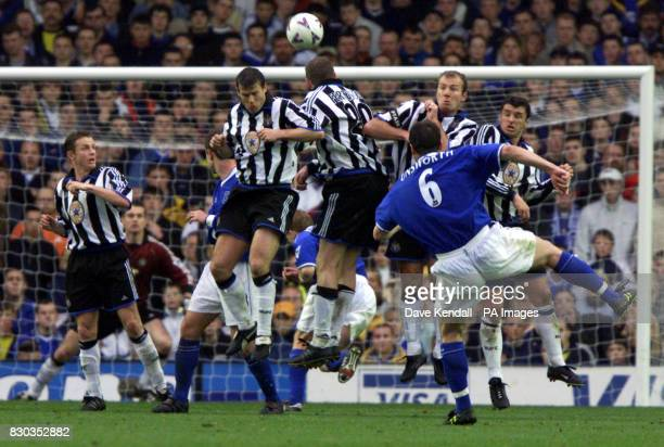 This picture can only be used within the context of an editorial feature Everton's David Unsworth beats the Newcastle United wall with his free kick...