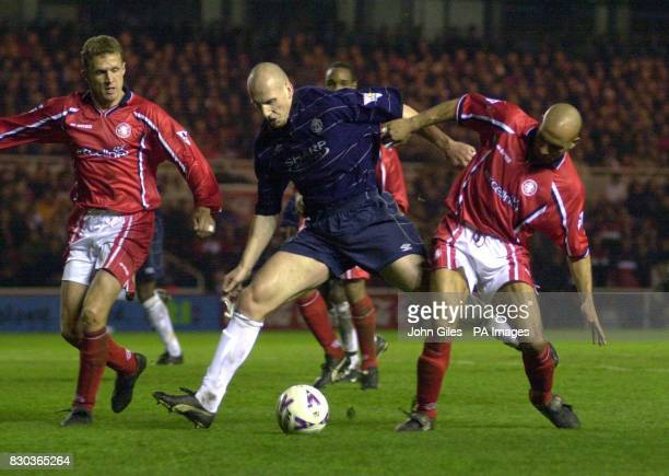 This picture can only be used within the context of an editorial feature Jaap Stam of Manchester United battles through the Middlesbrough defence...